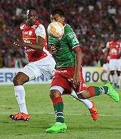 BOGOTÁ - COLOMBIA -09-12-2015: Yerry Mina (Izq) jugador de Independiente Santa Fe (COL) disputa el balón con Ramon Abila (Der) jugador de Huracan (ARG) durante partido de vuelta por cuartos de la final de la Copa Sudamericana 2015 jugado en el estadio Nemesio Camacho El Campín de la ciudad de Bogota./ Yerry Mina (L) player of Independiente Santa Fe (COL) vies for the ball with Ramon Abila (R) player of Huracan (ARG) during the second leg match for the final of the Copa Sudamericana 2015 played at Nemesio Camacho El Campin stadium in Bogota city.  Photo: VizzorImage/ Gabriel Aponte /Staff