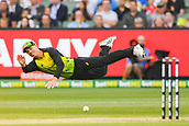 10th February 2018, Melbourne Cricket Ground, Melbourne, Australia; International Twenty20 Cricket, Australia versus England; David Warner of Australia dives to throw the ball at the wickets