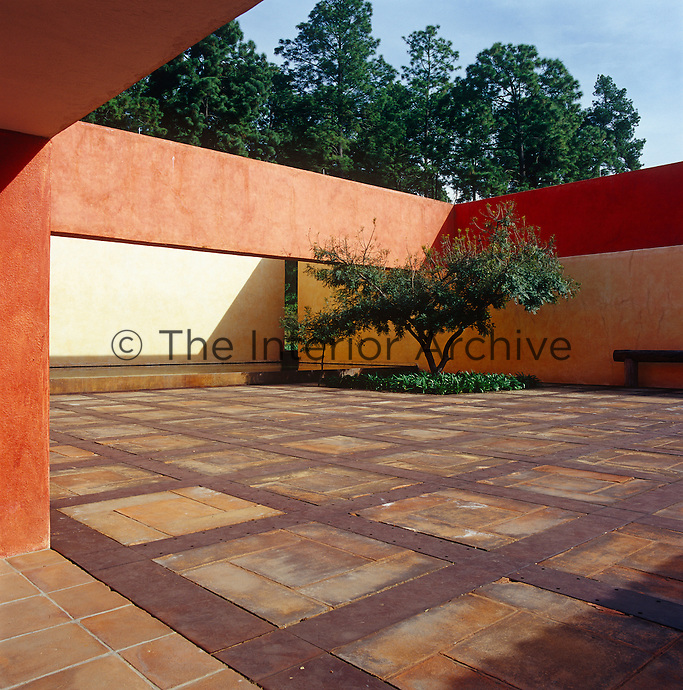 The floor of the courtyard mixes sections of ironwork with clay tiles for contrasting textures and the planting has been kept to a minimum