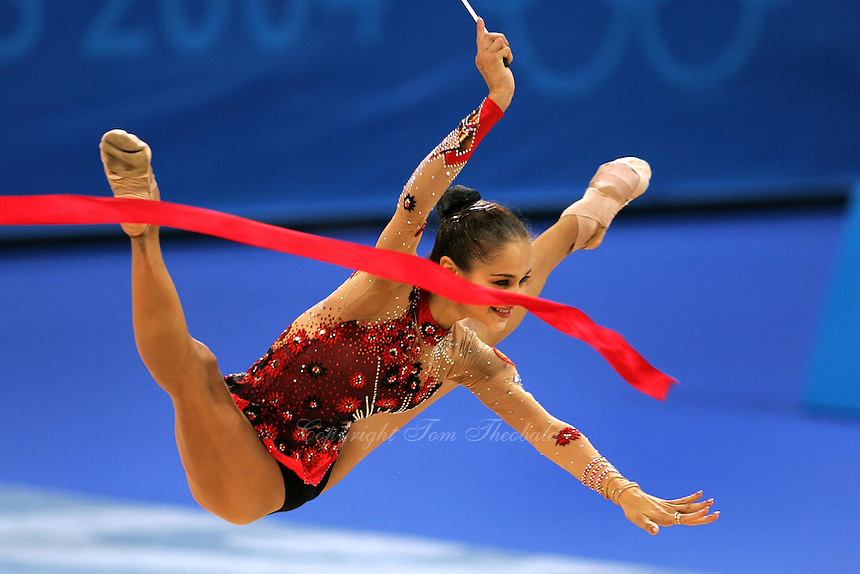 August 29, 2004; Athens, Greece; Rhythmic gymnastics star IRINA TCHACHINA of Russia (here straddle jumps with ribbon) won silver in All-Around competition at 2004 Athens Olympics.<br />
