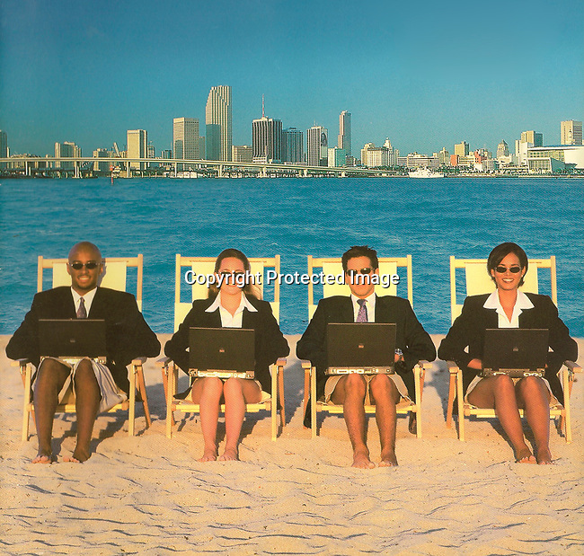 Graduate MBA students working on the beach.