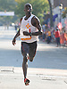 Nicholas Kipruto, 31, of Cooperas Grove, TX (Bib No. 5) legs out the final stretch of Northport's annual Cow Harbor 10-kilometer run on Saturday, September 19, 2015. He took third place with a time of  29:57.59.<br /> <br /> James Escher