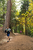 USA, Oregon, Ashland, running through Lithia Park in the Fall