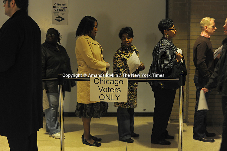 Early voters wait in line in the basement of a Cook County building at 69 W. Washington in Chicago, Illinois on October 29, 2008.  Lines averaged around an hour and all African-American voters surveyed who were voting for the first time were eligible for the first time, evidence of the efficiency of the Chicago machine in turning out registered and active voters.