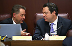 Nevada Senate Majority Leader Michael Roberson, R-Henderson, right, talks with fiscal analyst Russell Guindon in a committee hearing at the Legislative Building in Carson City, Nev., on Monday afternoon, March 23, 2015. <br /> Photo by Cathleen Allison