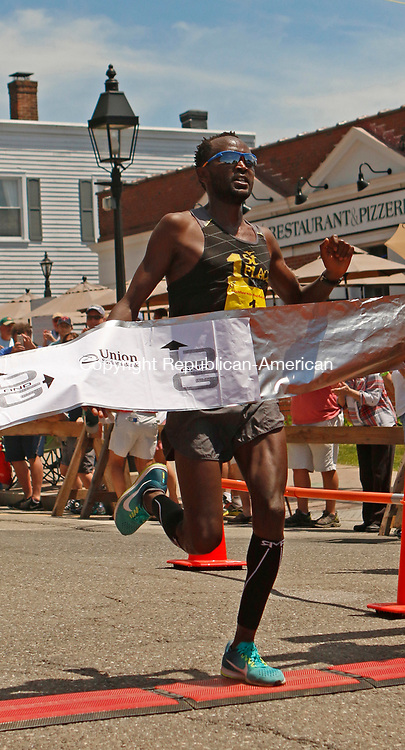 "Litchfield, CT-061117MK17 Eliud ""Heldy"" Ngetich crosses the finishline during the 41st Litchfield Hills Road Race Sunday afternoon in Litchfield.  Ngetich won the race with a time of 34 minutes 57 seconds and a 4:56 mile pace. Michael Kabelka Republican-American"