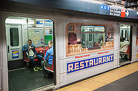 A Flushing line subway train in Times Square is wrapped in advertising promoting the new time for reruns of the Seinfeld television program on WPIX, seen on Sunday, May 18, 2014. The train is being touted as the first train to be completely branded, all of the cars are wrapped. The premise is to evoke Tom's Restaurant, a fictional meeting place for the characters of the program. (© Richard B. Levine)
