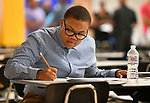 LaMyra Wynn of Florissant takes an assessment test at a Diversity Fair sponsored by the St. Louis County branch of the Ethical Society of Police. The fair was held at Hazelwood Central High School on Saturday August 11, 2018 with police agencies from ten different jurisdictions represented.   Photo by Tim Vizer