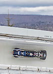 9 January 2016: United States of America pilot Steven Holcomb leads his 4-man team as they cruise through Curve 14 during their second run of the day at the BMW IBSF World Cup Bobsled Championships at the Olympic Sports Track in Lake Placid, New York, USA. Holcomb's team came in 8th for the day, with a 2-run combined time of 1:50.69. Mandatory Credit: Ed Wolfstein Photo *** RAW (NEF) Image File Available ***