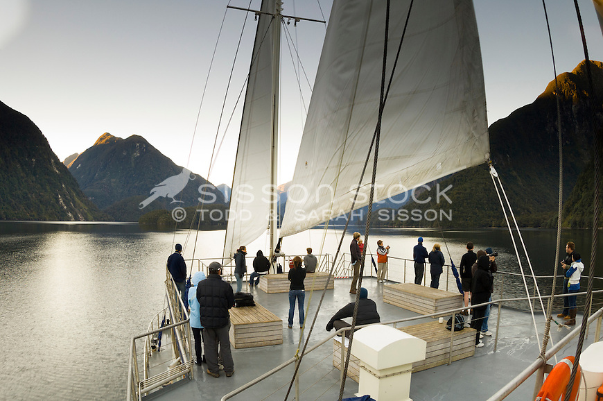Tourists aboard the Fiordland Navigator, Doubful Sound, New Zealand - stock photo, canvas, fine art print