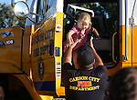 Jolyne Craig, 4, checks out a Carson City Fire Department engine during the 14th annual National Night Out in Carson City, Nev., on Tuesday, Aug. 2, 2016. <br />