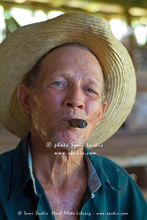 Portrait of a mature tobacco farmer smoking a cigar, Vinales, Pinar del Rio Province, Cuba.