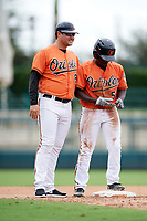 Baltimore Orioles coach Pat Leyland (84) and Jacob Brown (53) during an Instructional League game against the Tampa Bay Rays on October 5, 2017 at Ed Smith Stadium in Sarasota, Florida.  (Mike Janes/Four Seam Images)