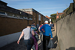 Supporters making their way out of the Mersey Travel Arena, home to Marine Football Club, after they played host to Ilkeston FC in a Northern Premier League premier division match. The match was won by the home side by 3 goals to 1 and was watched by a crowd of 398. Marine are baed in Crosby, Merseyside and have played at Rossett Park (now the Mersey Travel Arena)  since 1903, the club having been formed in 1894.