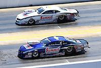 Sep 14, 2013; Charlotte, NC, USA; NHRA pro stock driver Buddy Perkinson (near) races alongside Greg Anderson during qualifying for the Carolina Nationals at zMax Dragway. Mandatory Credit: Mark J. Rebilas-