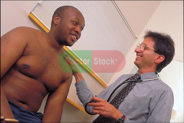 smiling doctor examining male patient