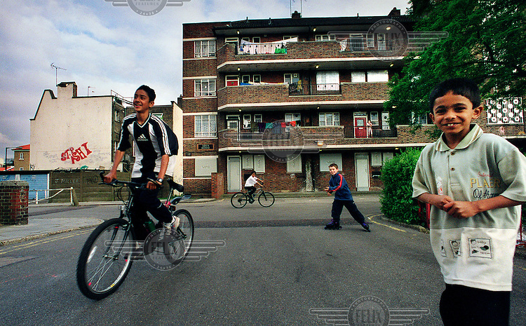 Children play on their bikes outside Ocean Estate in Tower Hamlets.