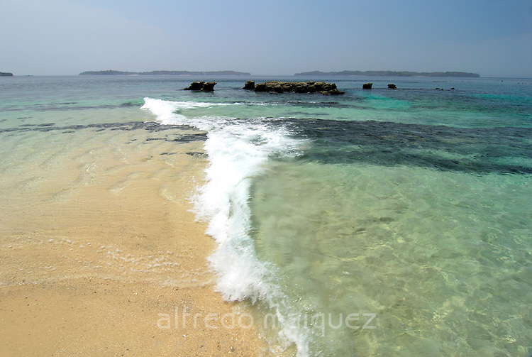 Waves coming to the beach at Bolanos island shore. Las Perlas archipelago, Panama province, Panama, Central America.