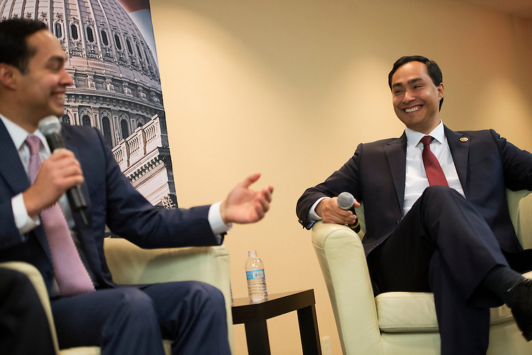 "UNITED STATES - MARCH 05:  Rep. Joaquin Castro, D-Texas, right, and his brother Julian Castro, mayor of San Antonio, share a laugh during a discussion at the ""SA to DC"" conference held at the Marriott at Metro Center. The event which, is organized by the Hispanic Chamber, the Greater San Antonio Chamber of Commerce and the Free Trade Alliance, brings business leaders and elected officials from San Antonio to advocate for the city. (Photo By Tom Williams/CQ Roll Call)"