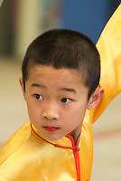 Children perform at the Beijing Children's Palace. Located in the former royal garden behind Jingshan Park, Beijing Children's Palace is one of the largest art after-school training centers in the country. In the past 50 years, thousands of kids have taken painting, calligraphy, photography, dancing, and singing, classes at Beijing Children's Palace..