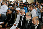 """Chairman of the political bureau of the Hamas Palestinian Islamist movement, Ismail Haniyeh attends the funeral of six members of Ezzedine al-Qassam Brigades, the armed wing of the Palestinian Hamas movement who were killed in an unexplained explosion the night before, in Deir al-Balah in the central Gaza strip on May 6, 2018. Gaza's health ministry confirmed six people were killed and three others wounded in what residents said appeared to be an accidental explosion in the Az-Zawayda area of the central Gaza Strip. Al-Qassam Brigades blamed Israel for the explosion without providing details or proof, saying incident occurred during a """"complex security and intelligence operation"""" and calling it a """"serious and large security incident"""". Photo by Ashraf Amra"""