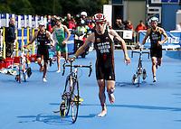 Photo: Richard Lane/Richard Lane Photography. GE Strathclyde Park Triathlon. 22/05/2011. Elite Men race. Josh Harris in transition.
