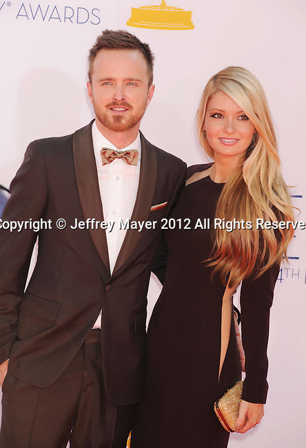 LOS ANGELES, CA - SEPTEMBER 23: Aaron Paul and Lauren Parsekian arrive at the 64th Primetime Emmy Awards at Nokia Theatre L.A. Live on September 23, 2012 in Los Angeles, California.