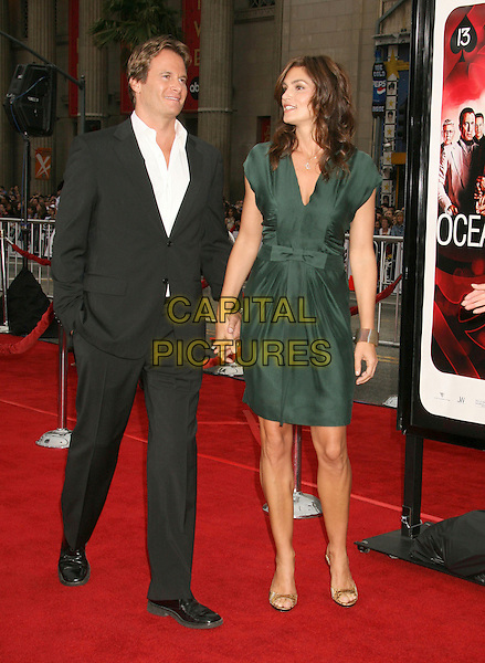 "RANDE GERBER & CINDY CRAWFORD.""Ocean's Thirteen"" Los Angeles Premiere held at Grauman's Chinese Theatre, Hollywood, California, USA..June 5th, 2007.full length black suit jacket green dress married husband wife bracelet holding hands.CAP/ADM/RE.©Russ Elliot/AdMedia/Capital Pictures"