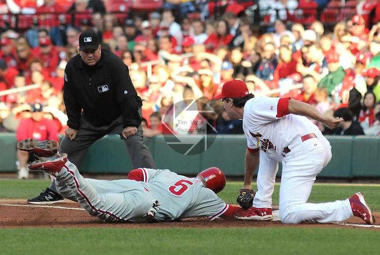 16 May 2011                              Philadelphia Phillies second baseman Pete Orr (5) dives back to first base to try to avoid the pickoff throw to St. Louis Cardinals firstbaseman Lance Berkman (12) but was out on the play. The St. Louis Cardinals defeated the Philadelphia Phillies 3-1 on Monday May 16, 2011 in the first game of a two-game series at Busch Stadium in downtown St. Louis.