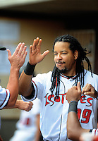 Jun. 23, 2009; Albuquerque, NM, USA; Albuquerque Isotopes outfielder Manny Ramirez greets teammates prior to the game against the Nashville Sounds at Isotopes Stadium. Ramirez is playing in the minor leagues while suspended for violating major league baseballs drug policy. Mandatory Credit: Mark J. Rebilas-