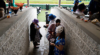 LOUISVILLE, KENTUCKY - MAY 04: Fans stand in their ponchos and hats to wait out the storm during Thurby at Churchill Downs on May 4, 2017 in Louisville, Kentucky. (Photo by Scott Serio/Eclipse Sportswire/Getty Images)