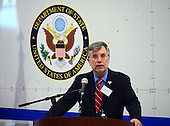 Patrick Kennedy, Under Secretary of Management from the United States Department of State gives remarks at the unveiling of the US State Department sponsored Containerized Biocontainment Systems units at Dobbins Air Reserve Base, Georgia, August 11, 2015. The two Containerized Biocontainment units built by MRIGlobal through a partnership with the U.S. State Dept. and the Paul G. Allen Ebola Program, will be positioned at Dobbins ARB, ready for future use. <br /> Mandatory Credit: Brad Fallin / USAF via CNP