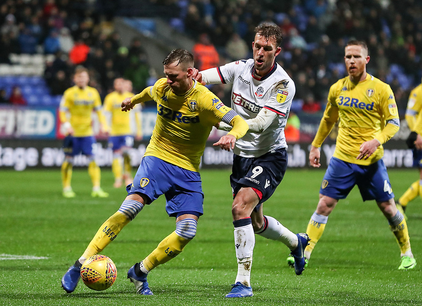 Bolton Wanderers' Christian Doidge competing with Leeds United's Barry Douglas<br /> <br /> Photographer Andrew Kearns/CameraSport<br /> <br /> The EFL Sky Bet Championship - Bolton Wanderers v Leeds United - Saturday 15th December 2018 - University of Bolton Stadium - Bolton<br /> <br /> World Copyright © 2018 CameraSport. All rights reserved. 43 Linden Ave. Countesthorpe. Leicester. England. LE8 5PG - Tel: +44 (0) 116 277 4147 - admin@camerasport.com - www.camerasport.com