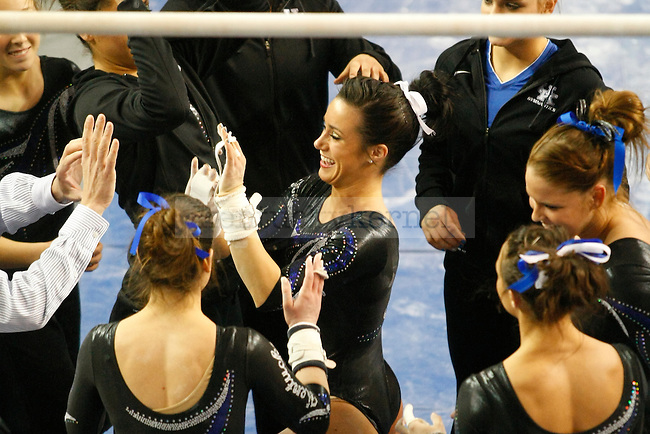 Sophomore Shelby Hilton celebrates with teammates after performing on the uneven bars at UK gymnastics vs. LSU at Memorial Coliseum in Lexington, Ky., on Friday, February 1, 2013. Photo by Tessa Lighty | Staff
