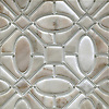 Maxwell, a handmade mosaic shown in Venetian honed Cashmere and Island Fog Serenity glass, is part of the Parterre Collection by Paul Schatz for New Ravenna.