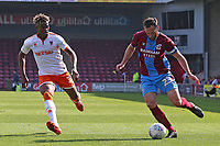 Blackpool's Armand Gnanduillet chases down Scunthorpe United's Rory McArdle<br /> <br /> Photographer David Shipman/CameraSport<br /> <br /> The EFL Sky Bet League One - Scunthorpe United v Blackpool - Friday 19th April 2019 - Glanford Park - Scunthorpe<br /> <br /> World Copyright © 2019 CameraSport. All rights reserved. 43 Linden Ave. Countesthorpe. Leicester. England. LE8 5PG - Tel: +44 (0) 116 277 4147 - admin@camerasport.com - www.camerasport.com