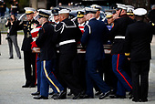 The flag-draped casket of former President George H.W. Bush is carried by a joint services military honor guard after a State Funeral at the National Cathedral, Wednesday, Dec. 5, 2018, in Washington. <br /> Credit: Alex Brandon / Pool via CNP