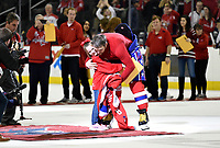 WASHINGTON, DC - APRIL 06: Washington Capitals left wing Alex Ovechkin (8) gives a young girl fan a hug as he gives her the jersey off his back after the final game of the season as part of Fan Appreciation Game after the New York Islanders vs. the Washington Capitals NHL game April 6, 2019 at Capital One Arena in Washington, D.C.. (Photo by Randy Litzinger/Icon Sportswire)