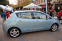 Full length view of Nissan Leaf Zero Emission Tour promotional event for the Nissan Leaf electric car that is scheduled to be released in Fall 2010. Car specs from Nissan: 5 person capacity, 90 MPH top speed, lithium-ion battery, 100 mile average range per charge. Santana Row, San Jose, California, USA, 12/5/09