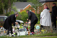 Pictured: Undertakers carry the coffin of baby Sion at the burial site at Thornhill Cemetery, Cardiff, Wales, UK. Tuesday 28 June 2016<br /> Re: The funeral of Sion, the baby boy found dead in the River Taff in Cardiff has taken place<br /> Generous locals raised nearly £1,400 for the memorial after reading about plans to hold a fitting ceremony for the newborn baby whose body was discovered in Cardiff a year ago.<br /> The funeral took place at the Briwnant Chapel at Thornhill Crematorium, Cardiff. Members of the public are invited to be among the congregation.
