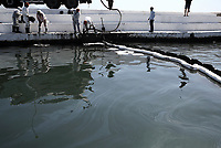 Pictured: Specialist crew clean up the oil spill that has reached the coast of Salamina, Greece<br /> Re: An oil spill off Salamina island&rsquo;s eastern coast is spreading and has become &ldquo;an environmental disaster&rdquo; according to local authorities in Greece.<br /> The spill was caused by the sinking of the Aghia Zoni II tanker, carrying 2,200 metric tons of fuel oil and 370 metric tons of marine gas oil on Saturday, southwest of the islet of Atalanti near Psytalleia. According to reports, the coastline stretching from Kinosoura to the Selinia community has &ldquo;turned black&rdquo; and authorities fear a new leak from the sunken ship.<br /> According to the island&rsquo;s mayor, Isidora Papathanasiou, the weather &ldquo;turned on Sunday afternoon and brought the oil spill to Salamina.&rdquo;