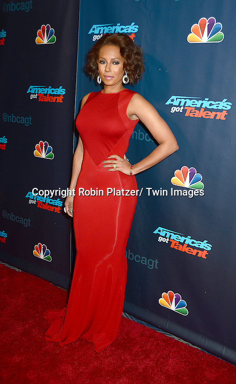 "Mel B in red Stella McCartney dress attends the ""America's Got Talent"" pre show red carpet on September 17, 2013 at Radio City Music Hall in New York City."