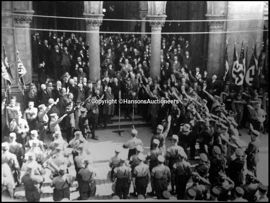 BNPS.co.uk (01202 558833)<br /> Pic: HansonsAuctioneers/BNPS<br /> <br /> A Nazi rally in the 1920's.<br /> <br /> A camp photo of a knobbly-kneed Adolf Hitler that he later tried to ban has been unearthed in an album taken as a souvenir by a British soldier 73 years ago.The black and white snap depicts the evil dictator sat arms crossed on a chair wearing lederhosen and knee-high socks with his bare legs on display.The snap, taken in the 1920s, has been found in an album recovered from the home of notorious Nazi Viktor Lutze. It will be sold by Hansons Auctioneers.