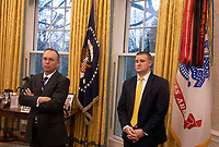 Acting White House Chief of Staff Mick Mulvaney, left, looks on as United States President Donald J. Trump makes remarks as he greets Prime Minister Kyriakos Mitsotakis of Greece in the Oval Office of the White House in Washington, D.C. on Tuesday, January 7, 2020.     <br /> Credit: Tasos Katopodis / Pool via CNP/AdMedia