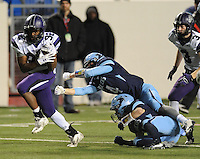 NWA Democrat-Gazette/ANDY SHUPE<br /> Javontae Smith (32) of Fayetteville escapes the grasp of Brady Patrick of Har-Ber Saturday, Dec. 5, 2015, on his way to the end zone during the second half of the Class 7A state championship game at War Memorial Stadium in Little Rock. Visit nwadg.com/photos to see more photographs from the game.