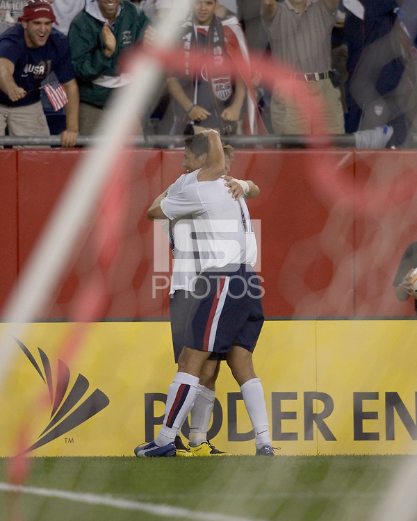 Taylor Twellman (United States, white shirt) and Brian Ching (United States, white shirt) celebrate Twellman's goal. Ching assisted. The United States defeated El Salvador, 4-0, in the first round of the CONCACAF Gold Cup, in Gillette Stadium, Tuesday, June 12, 2007.