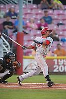 Luke Tendler #17 of the Spokane Indians bats against the Salem-Keizer Volcanoes at Volcanoes Stadium on July 26, 2014 in Keizer, Oregon. Spokane defeated Salem Keizer, 4-1. (Larry Goren/Four Seam Images)