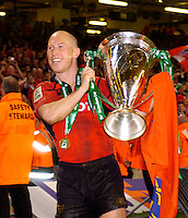 Cardiff, WALES.  Munster's Peter Stringer holds the Heineken Cup after Munster win th 2006 Heineken Cup Final, at the Biarritz Olympique vs Munster Rugby, Millennium Stadium, Biarritz Olympique, 23 points to 19 Stringer also picked up the man of the match award.  20.05.2006. © Peter Spurrier/Intersport-images.com,  / Mobile +44 [0] 7973 819 551 / email images@intersport-images.com.   [Mandatory Credit, Peter Spurier/ Intersport Images].14.05.2006   [Mandatory Credit, Peter Spurier/ Intersport Images].