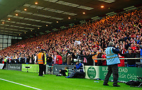Lincoln City fans celebrate their teams goal, scored by Harry Anderson<br /> <br /> Photographer Chris Vaughan/CameraSport<br /> <br /> The Carabao Cup Second Round - Lincoln City v Everton - Wednesday 28th August 2019 - Sincil Bank - Lincoln<br />  <br /> World Copyright © 2019 CameraSport. All rights reserved. 43 Linden Ave. Countesthorpe. Leicester. England. LE8 5PG - Tel: +44 (0) 116 277 4147 - admin@camerasport.com - www.camerasport.com