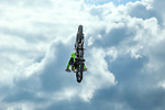 Motocross riders compete in the Coors Light Free style event during the summer X-Games at the Circuit of the Americas race track in Austin, Texas during some dramatic storms.
